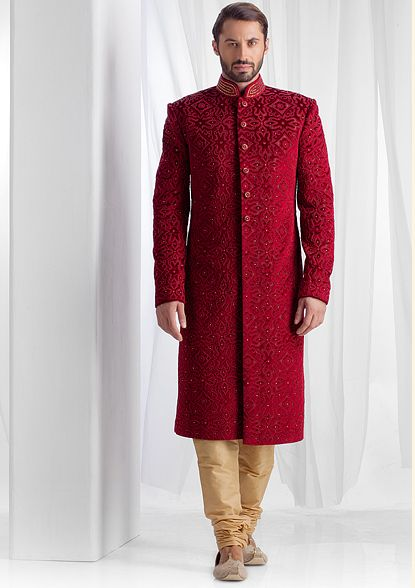 Velvet sherwani embellished with applique and moti embroidery