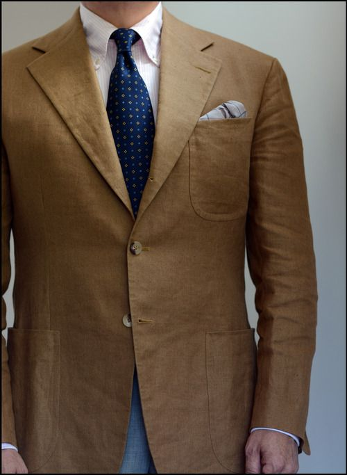 Brown sport coat, pink OCBD, navy tie with white pin dots