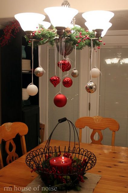Ornaments over the table.: Lights Fixtures, Cute Ideas, Kitchens Tables, Holidays Decor, Christmas Decor, Dining Rooms Chandeliers, Christmas Ideas, Christmas Tables Decor, Hanging Ornaments