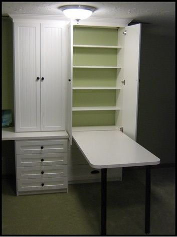 I could use this in my laundry room! Drop down folding table, put away when done, shelves to store laundry detergent, bleach, fabric softener, etc. All neatly tucked away where my husband doesn't fuss...