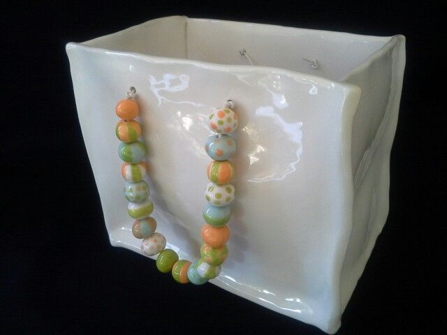 DIANE KOTZAMANIS.....Bag with beads....all ceramic....facebook page DK ceramics.......Diane Kotzamanis...... https://m.facebook.com/pages/DK-Ceramics/476698149067003