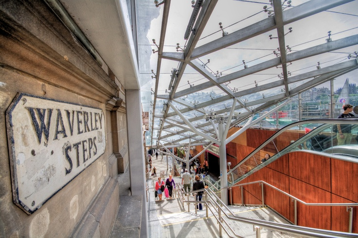 Stainless steel structural glass canopy. This canopy covers the famous 'Waverley Steps' and has transformed the entrance to Edinburgh's Waverley Train Station in Scotland