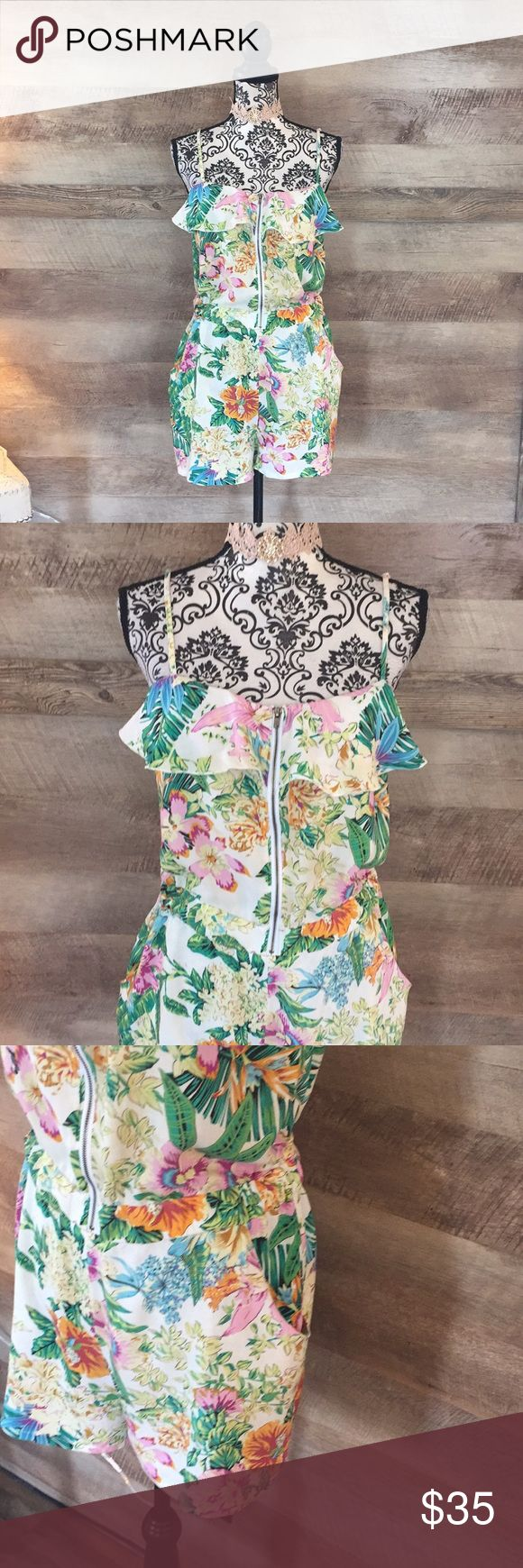 Palm Tree Floral Zip Up Romper Size XL. Drop Waist that is wide elastic. Zip up bodice. Ruffled neckline. Adjustable straps. Floral print with palm trees. Pockets in the front. 100% rayon. Pants Jumpsuits & Rompers