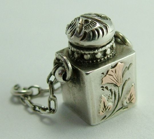 Sandys Vintage Charms ~ perfume bottle that opens:)