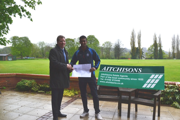 Andy presenting Hamish of Hemel Hempstead Town Cricket Club with our sponship cheque for the new season