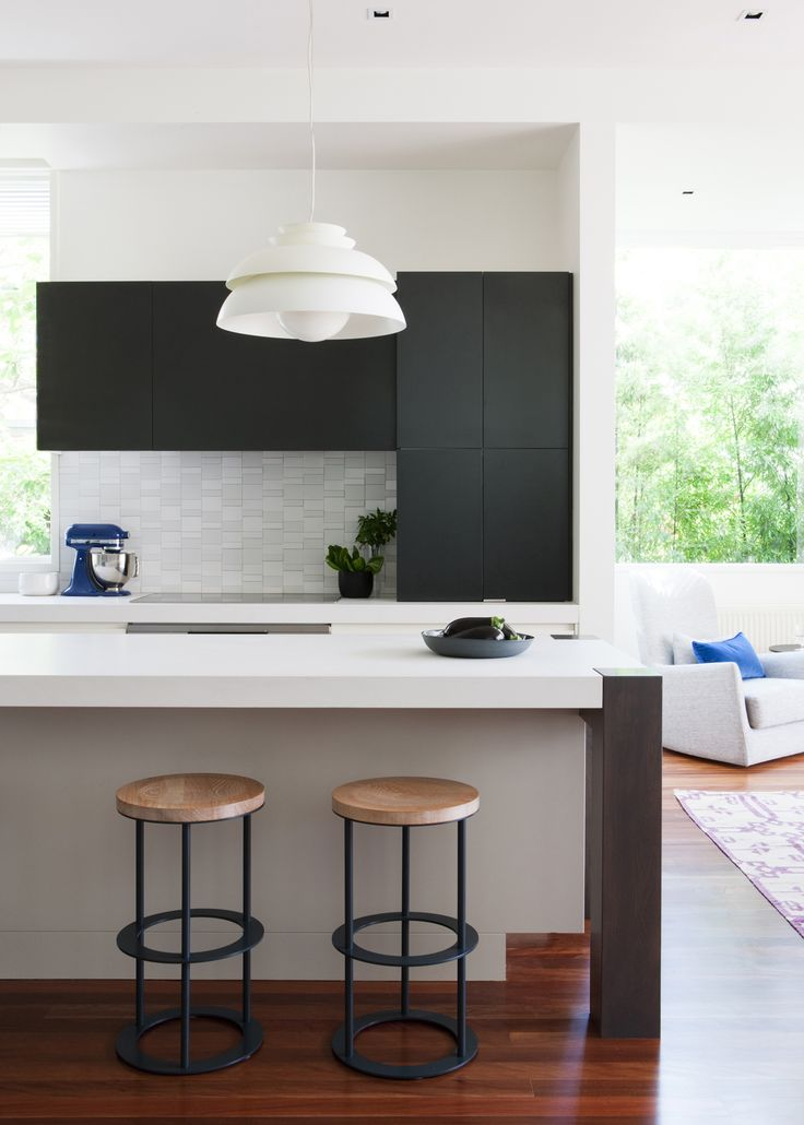 Doherty Design Studio's Armadale Residence Kitchen. Photographer: Gorta Yuuki Love this with the black leg feature on island and thickness of bench top