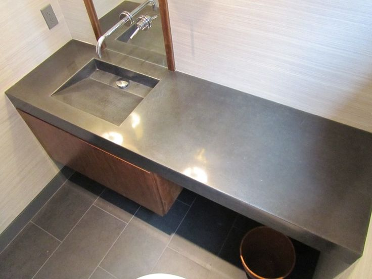 "4"" face wetcast concrete sink with internal in in the rich Charcoal color."