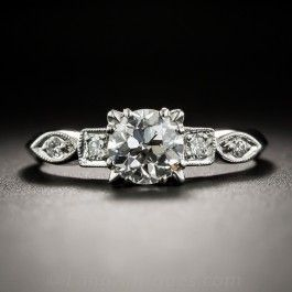 Circa 1940d-50s, this classic solitaire engagement ring highlights a bright-white, high-quality, transitional European-cut diamond, weighing .89 carat. The scintillating stone sparkles between sleekly designed shoulders, each set with a pair of small round diamonds: one set in a square setting, followed by a navette shape setting, leading in turn to a soft knife-edge ring shank. A timeless vintage jewel. GIA Diamond Grading Report stating: G color - VS1 clarity. Currently ring size 7 1/2.