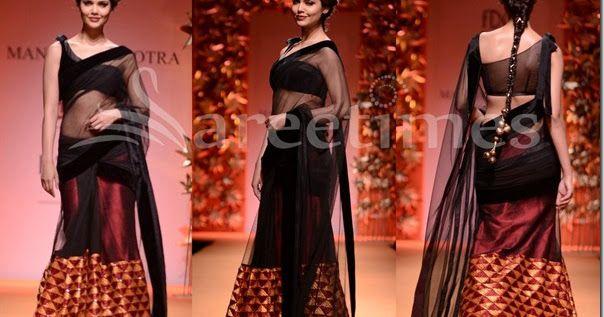 Bollywood actress Esha Gupta  in beautiful black and maroon designer transparent saree. Designed by Manish Malhotra at Day 3 WIFW Autumn...