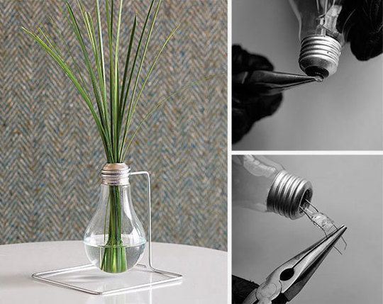 I saw some of these Lightbulb vases at a Craft Herb Faire... They were hanging on a limb with flower cuttings... Really pretty. ~ Lightbulb Bud Vase 10 Interesting DIY Ideas.