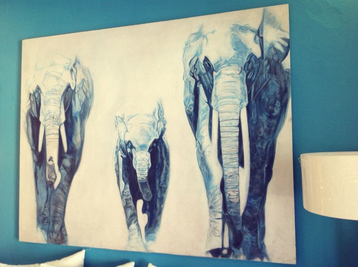 White acrylic hand painting with three blue elephants by Chora Art Home design.