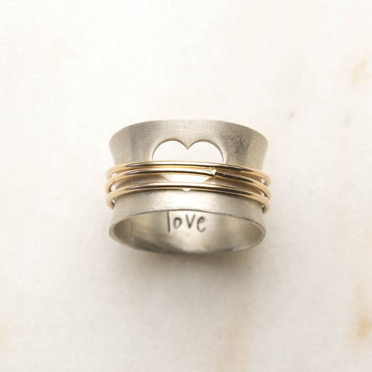 I look around and see love. Even with the pain life brings, there is so much good and kindness. In dark times I feel love's presence even more profoundly. I am surrounded by love. Choose a gold-filled spinner to represent each of your loves. This ring is precious and full of meaning!