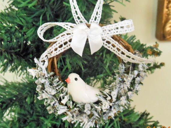 These are brand new ornaments for your tree! These darling ornaments are a great addition to a tabletop tree. They are small and sweet - 3 inch round grapevine wreath ornaments decorated with artificial greenery, artificial snow, glittered branches, mini white Dove, and a white crochet ribbon. This is for a set of 3. These make a great gift to someone special, especially to those bird lovers! You can add these to a tabletop tree as they are lightweight. Thanks for looking and have a Happy…