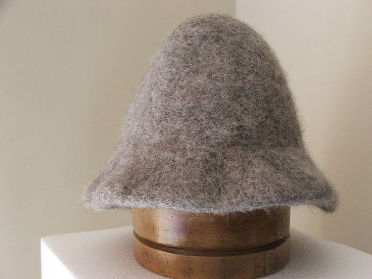 """Irish Monmouth Cap in gray (aka the Peter the Great cap). """"Elizabeth I, in order to increase the wool trade and production amended the sumptuary laws in 1571 .. 'An Act for the Continuance of the Making of Caps'  lists fifteen crafts related to their production, also required … all [males] above the age of six years except some of certain state and condition, shall wear upon the Sabbath and Holydays, one cap of wool knit, thicked and dressed in England, upon the forefeiture of 3s 4d …'"""""""