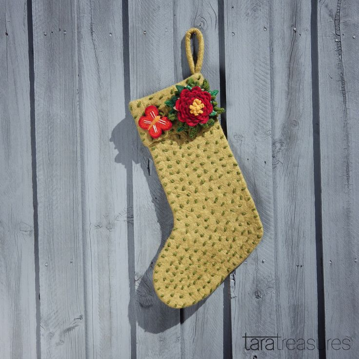 It need not be Christmas for you to get a felt stocking. Get it filled daily with your favourite goodies like chocolates. Adorned with butterflies and flowers, it's the perfect accessory for your home in Spring! Choose from 2 colour options: Green and White. #christmas