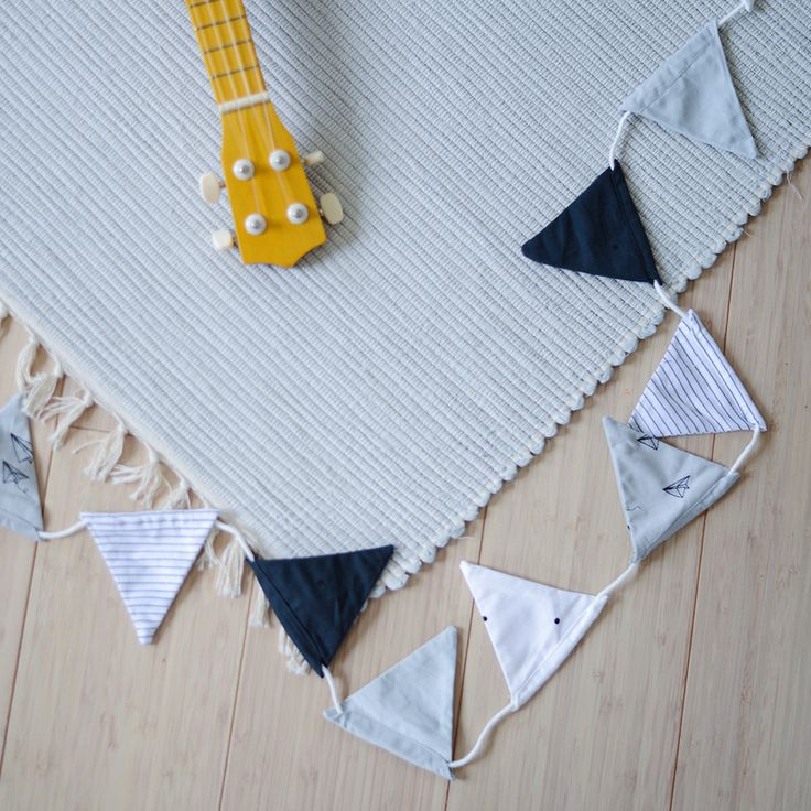 Rug in colour dumbo grey + flags made of organic cotton from LIEWOOD.