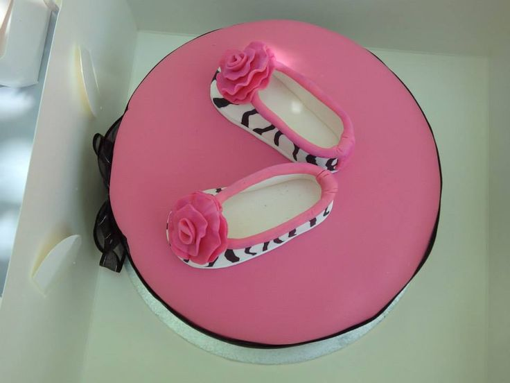 An the little shoes i made out of fondant to match her party shoes