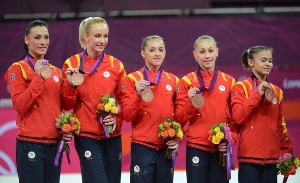 (From L) Bronze medalist Team Romania Catalina Ponor, Sandra Raluca Izbasa, Larisa Andreea Iordache, Diana Maria Chelaru and Diana Laura Bulimar celebrate on the podium after winning the bronze medal at the women's team competition of the artistic gymnastics event of the London Olympic Games on July 31, 2012 at the 02 North Greenwich Arena in London. The United States triumphed in the women's team gymnastics final on Tuesday to claim their first Olympic gold medal in the event since the 1996…