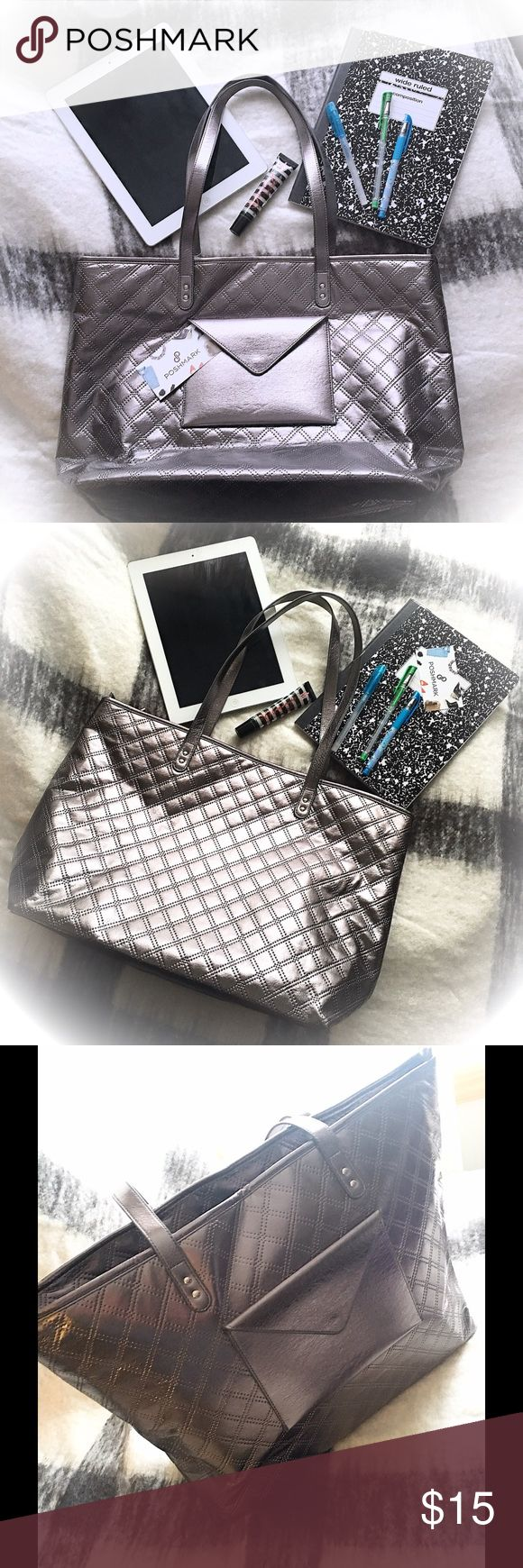 """Gorgeous Silver Tote Bag NWOT ~ Gorgeous Silver Tote Bag. 11.5⬆️x18↔️x6↕️ 10"""" double shoulder strap hang. Zip closure. Great for an on the go job. Fits laptops and tablets nicely. The exterior pocket is handy for holding stash cash for tips or business cards.  TRADES️️ MAKE A REASONABLE OFFER Bags Totes"""
