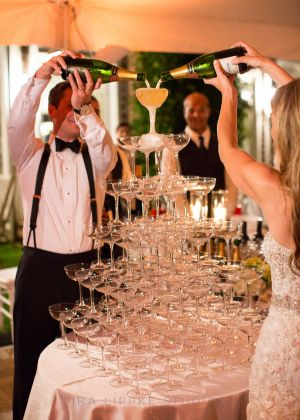 Romantic Fall Wedding in the Hamptons with a fun champagne tower   Rentals: Party Rental Ltd.   Event Planning: Daughter of Design   Event Design: Rock Paper Scissors   Photography: Ira Lippke Studios   Floral Design: Flowers by Beth