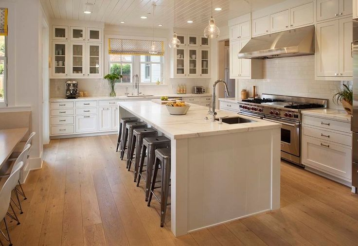 The kitchen's flow-through floor plan minimizes congestion and makes it easier for others to help with the meals or simply watch