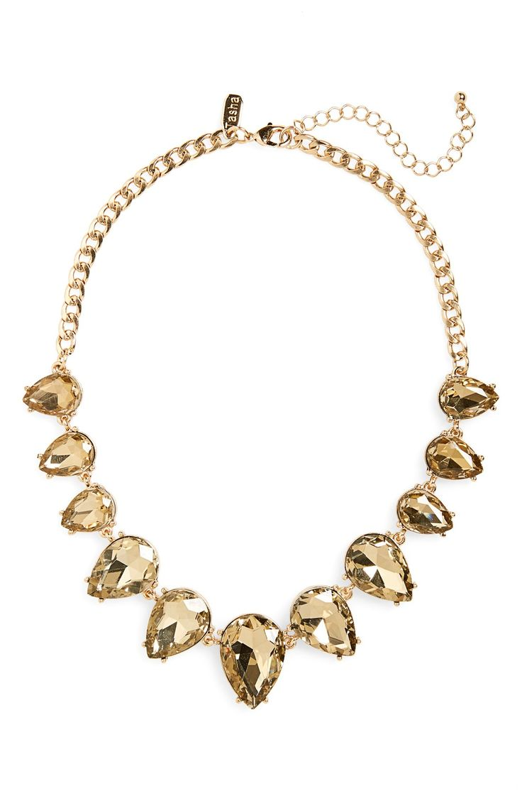 Teardrop stones sparkle and shimmer on this sophisticated gold necklace that makes a bold vintage statement. Pair with the perfect LBD for a chic and elegant style.