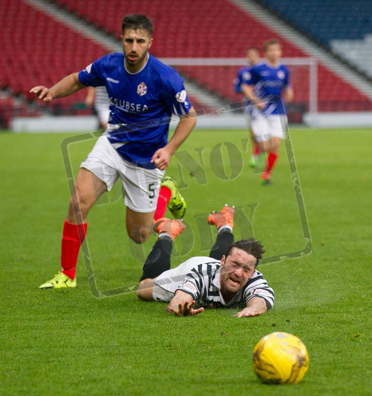 Queen's Park's Chris Duggan is brought down during the SPFL League One play off game between Queen's Park and Cowdenbeath.