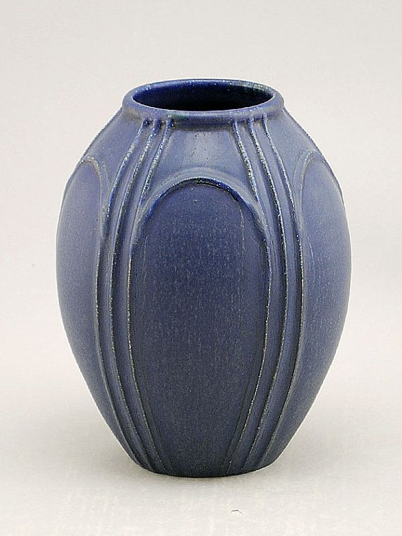"""Designed with the bridges of Venice in mind, the Venice vase showcases strong architectural elements and a simple balance of proportion and shape. This contemporary vase is glazed in our deep, rich Arts and Crafts Blue, just like the waters under the bridges of Venice! - 8""""h x 6.25""""w  Thrown by John Tiller  Designed and decorated by Nicky Ross  Glazed by Scott Draves"""
