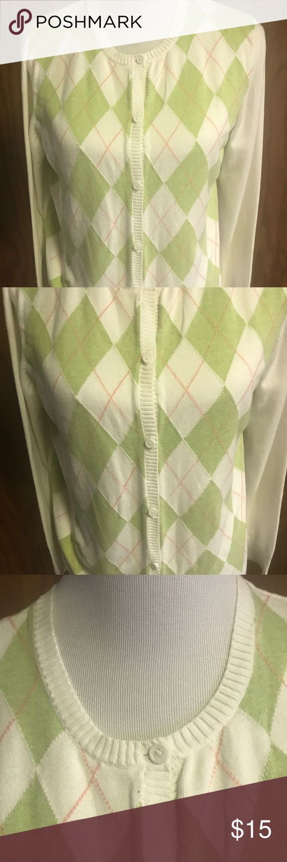 """Cherokee Brand Argyle Sweater Size Xl Button Down Cherokee Brand Size XL argyle sweater button down front green and coral on white color fabric. Long sleeves and 6 button down closure ribbed knit bands on cuff and hem. Measurements laying flat and buttoned: shoulder to hem 34"""" underarm to underarm 19"""" Sleeve 23"""" Cherokee Brand Sweaters Cardigans"""