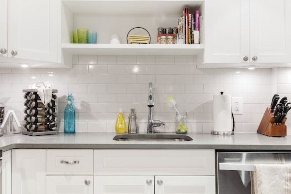 The couple chose white subway tiles for their new backsplash, which reflect a bright glow thanks to under-cabinet lighting.