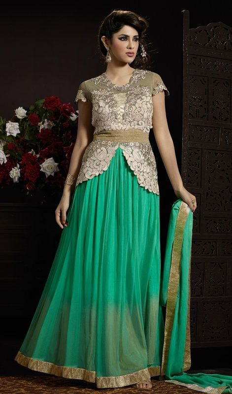 Amass your admirers mesmerized adorned in this Anarkali suit in green and gray color embroidered net. This charming attire is showing some remarkable embroidery done with lace, resham and stones work. #stunningstyleanarkali #newdesigndresses #anarkalionlinecollection
