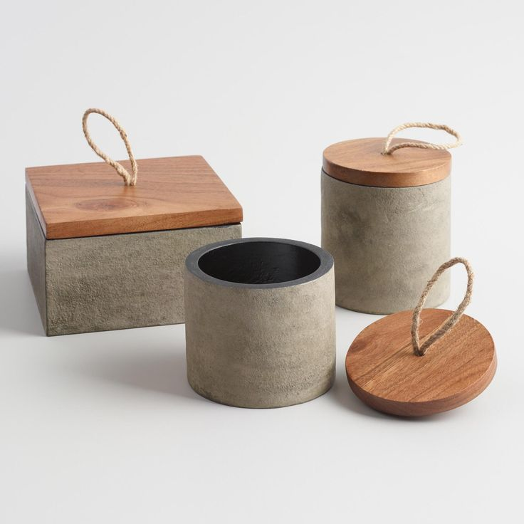Cast from a concrete composite, this lightweight little box adds an earthy note to your desk and hides coins, keys and trinkets. It's fitted with a natural-finished wooden lid and a jute rope handle.