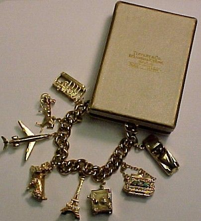 I'm obsessed with charm bracelets. There's something so whimsical and sweet about them. I have several silver so now I want a gold one like this