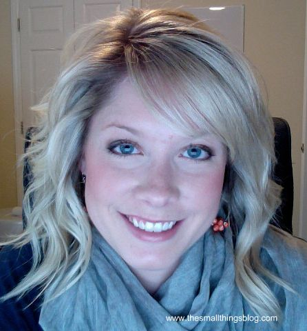 I freakin love this lady. She shows how to curl w/ a flat iron and how to style sweepy bangs. I'm a little 'short bus' when it comes to my bangs. :[  The Small Things Blog