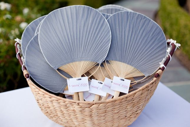 Paddle Fans. Keep guests cool during an outdoor wedding with these fans from theKnot.com Wedding Shoppe