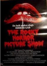 "Rocky Horror Picture Show - Danish Poster. Size: 33 1/2"" x 24"". Printed in Denmark. Description: Lips and Logo design without typical perimeter white border. ""En helt anden slags DODENS GAB"" written between lips and logo. Film cast and crew credits listed below logo, written in Danish. Printed in bottom left: Twentieth Century-Fox Film Logo. Printed in bottom right: print logo of ""Peter Jorgensen, Offset - Bogtayk""."