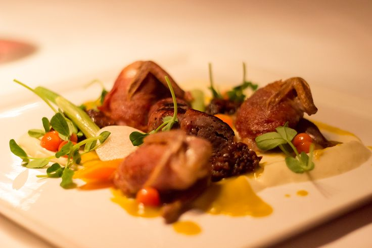 Venison Sausage and Quail with parsnip purée fig marmalade,  and sage butternut coulis.