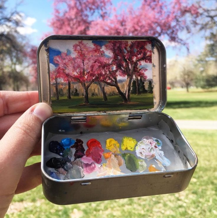 She paints tiny masterpieces in her empty Altoids tin