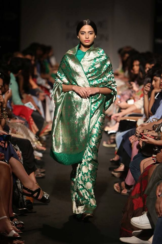 From Lakme Fashion Week Winter Festive 2014 edition. Beautiful sarees in luxurious fabrics by Sanjay Garg - we loved them!