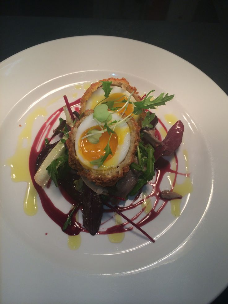 Confit of duck, duck egg, port and orange reduction