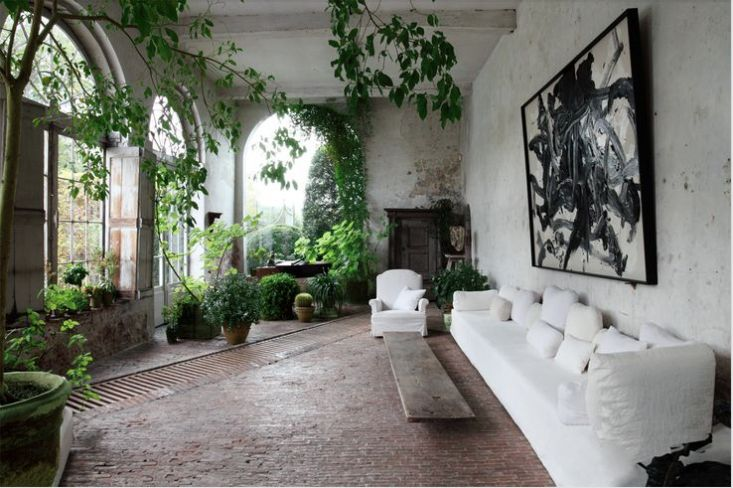 Belgian design impresario Axel Vervoordt 's conservatory uses a dramatic French drain as a design element, running across the floor like the border on a carpet.* axel-vervoordt-castle-conservatory-garden-gardenista