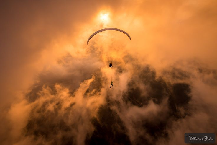 Happy new year everyone ! - Towards the sun and trough a hole in the clouds with Ferdi Toy & Guillaume Galvani in beautiful Oludeniz, Turkey. #Parapente #BaseJump #DreamTeam #Sunset #Clouds #Elinchrom #WhatAYear (c) www.TristanShu.com