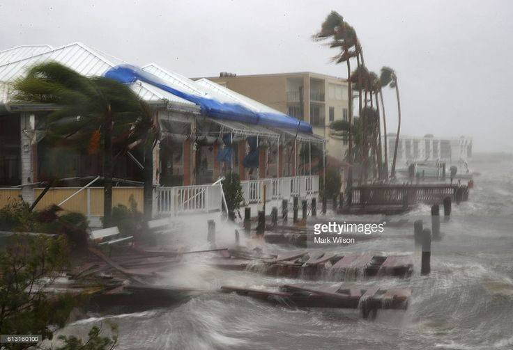 Heavy waves caused by Hurricane Matthew pound the boat docks at the Sunset Bar and Grill, October 7, 2016 on Cocoa Beach, Florida. Hurricane Matthew passed by offshore as a catagory 3 hurricane bringing heavy winds and minor flooding.