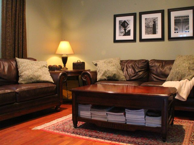 We transformed a basic bland living room into this cozy and inviting living room on a tight budget.