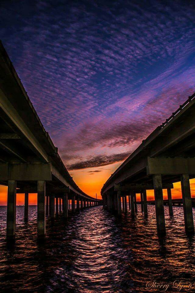 LAKE PONTCHARTRAN CAUSEWAY BRIDGE.....Mandeville to New Orleans, Louisiana....composed of two parallel bridges crossing Lake Pontchartrain....longest bridge over water in the world....the longer of the two bridges is 23.83 miles long.....supported by 9,500 concrete pilings.....opened in 1956.... operates as a toll bridge