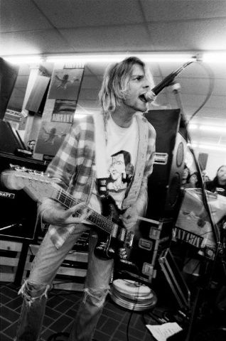 "Kurt Cobain playing his Fender Jaguar guitar during Nirvana's ""Nevermind"" release party on Sept. 16, 1991."