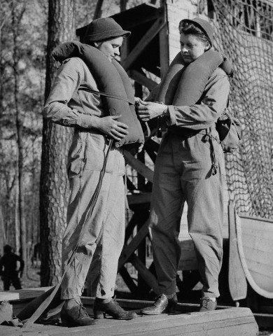 WACs Helping Each Other with Life Vests   WAC Private Ruth Hawley, of Troy, New York, gets some help adjusting her life belt from Lesta Porter, of Independence, Ohio during their training at staging camp in Virginia ~