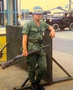 Air Force Security Policeman on guard at Bien Hoa Air Base, Vietnam Nam...Note the shotgun...