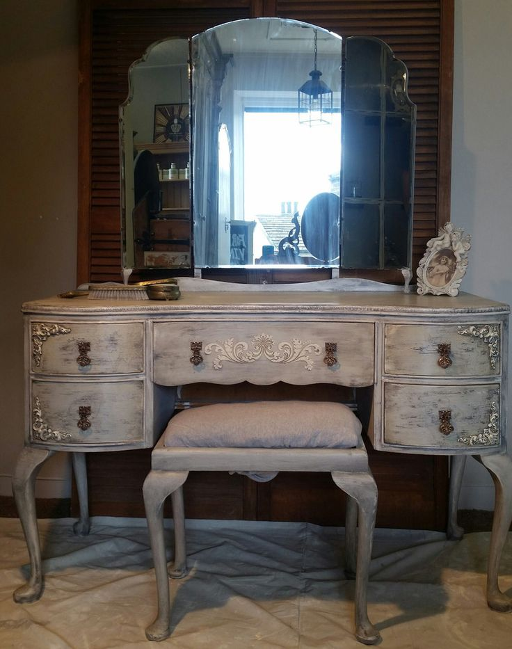 Louis style kidney shaped dressing table with triptic mirror and stool. Painted in Lady Grey over porcelain from the Everlong Paint range. The wonderful effect where all created using numerous wonderful products by Artisan Enhancements. A crackle glaze was added to give a chipped/crackle effect a dark grey scumble glaze emphasises the textured brush strokes