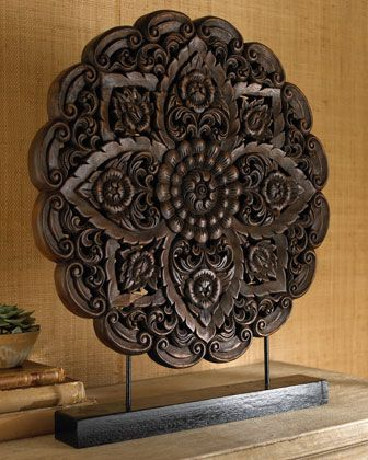 Wooden sculptures add touches of whimsy, as well as a silent nod toward the mandala. - Hen